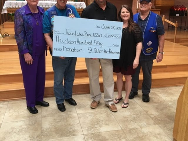 St. Peter the Fisherman Catholic church in Mountain Home recently donated $1,350 to the Twin Lakes Base of the USSVI to help with feeding and clothing local veterans. Pictured are: (from left) Priscilla Grant, AssistantMember;Curtis Grant, Past Base Commander andChaplin;Mike Davenport, Base Commander;Brandi Noval, Director of Youth Ministry at St. Peter's; andThomas Hanby, Treasurer.
