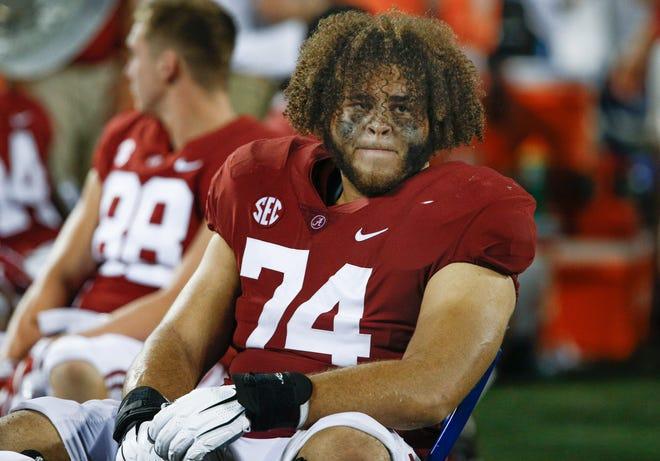 Alabama Crimson Tide offensive lineman Jedrick Wills Jr. (74) on the bench during a game against the Louisville Cardinals in September 2018.