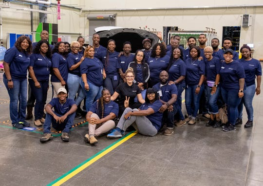 Gerhardi, Inc., employees pose for photos during the grand opening of Gerhardi, Inc., a German auto manufacturing supplier, located at the Montgomery County Industrial Park In Montgomery, Ala., on Wednesday July 10, 2019.