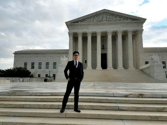 "Simon ""Young"" Tam of the band The Slants stands in front of the U.S. Supreme Court."
