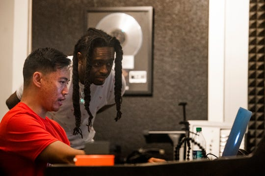 Bao Pham, the Montgomery rap engineer and producer, works with TheRealPIT in his studio in Montgomery, Ala., on Wednesday July 10, 2019. Pham recently moved to Shanghai, but is back in town briefly to produce music.