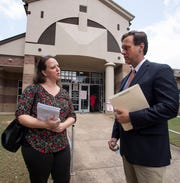Melissa Fridlin Murrell, a certified court interpreter and owner of Deep South Language Services, speaks with attorney Clay Benson outside of the juvenile court building In Montgomery, Ala., on Wednesday July 10, 2019.