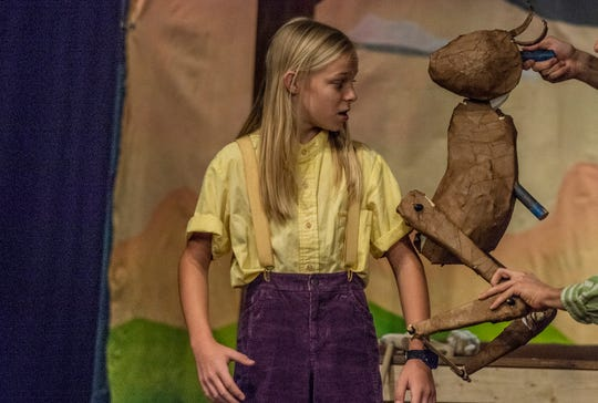 Pinocchio, played by 12-year-old Jason Grinstead, interacts with a talking cricket puppet during rehearsal Tuesday, July 9, 2019, at the Cloverdale Playhouse in Montgomery.