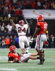Jan 8, 2018; Atlanta, GA, USA; Alabama Crimson Tide linebacker Terrell Lewis (24) celebrates after tackling Georgia Bulldogs quarterback Jake Fromm (11) in the 2018 CFP national championship college football game at Mercedes-Benz Stadium. Mandatory Credit: Mark J. Rebilas-USA TODAY Sports