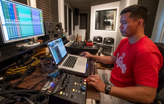 Bao Pham, the Montgomery rap engineer and producer, is shown recording TheRealPIT in his studio in Montgomery, Ala., on Wednesday July 10, 2019. Pham recently moved to Shanghai, but is back in town briefly to produce music.