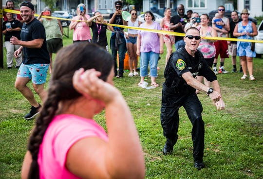 City and county police officers helped local children beat the summer heat by hosting a community water balloon fight at Heekin Park Wednesday afternoon. More than a hundred children attended the event.
