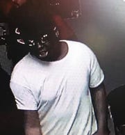 One of the men who robbed employees of the T-Mobile store, 424 E. McGalliard Road, shortly after 2 p.m. Tuesday is seen in a surveillance photo.