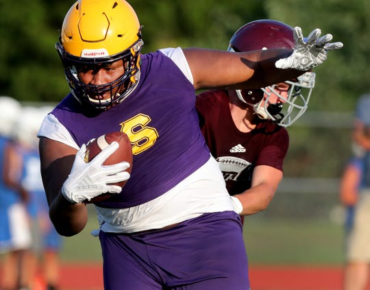 Smyrna's Dallas Walker runs the ball during Smyrna High School's 7-on-7 football games between Smyrna, Rockvale, Shelbyville and Franklin, on Tuesday, July 9, 2019.