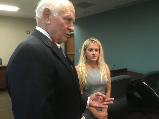 Kelsey Ketron, right, listens as attorney Aubrey Harwell discusses Wednesday's appearance in the Tennessee Department of Commerce and Insurance's court.
