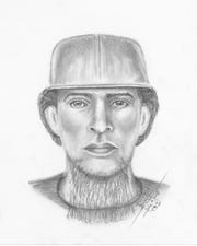 Police released a sketch of a man accused of grabbing a woman in a park.