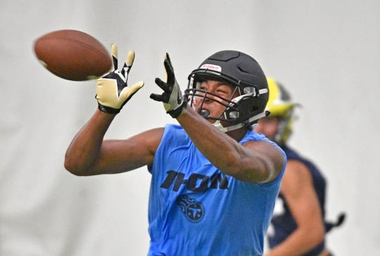 Ravenwood's Reggie Grimes II tries to make an interception as the Tennessee Titans host their annual 7-on-7 passing tournament for a group of local high school football teams Wednesday, July 10, 2019, in Nashville, Tenn.