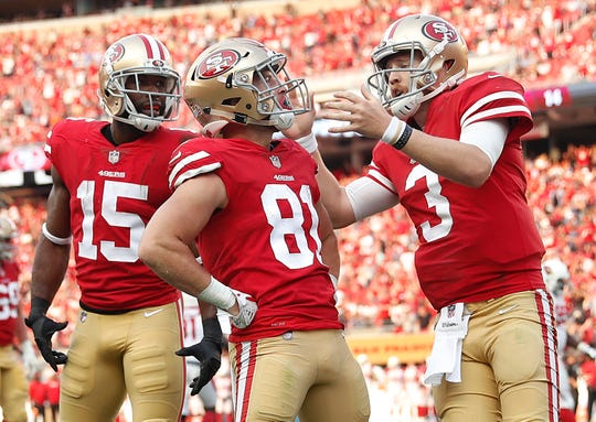 San Francisco 49ers wide receiver Trent Taylor (81) is congratulated by wide receiver Pierre Garcon (15) and quarterback C.J. Beathard (3) after scoring against the Arizona Cardinals on Oct. 7, 2018.