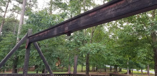 Picture of some worn away areas of the Treehouse Playground in Bowie Park in Fairview.