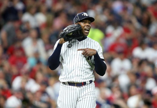 Jul 9, 2019; Cleveland, OH, USA; American League pitcher Aroldis Chapman (54) of the New York Yankees reacts during the ninth inning in the 2019 MLB All Star Game at Progressive Field. Mandatory Credit: Charles LeClaire-USA TODAY Sports
