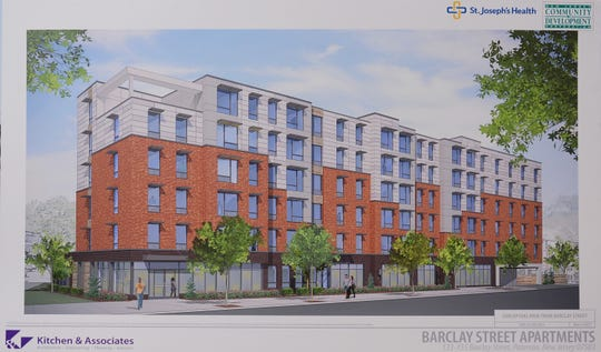 An architect's rendering of the 71-unit apartment building planned near St. Joseph's Regional Medical Center for low- and moderate-income residents, as well as frequent users of the emergency room. The project, a combined investment of the state and hospital,  is the first in a  partnership of the New Jersey Housing and Mortgage Finance Agency with the state's hospitals.