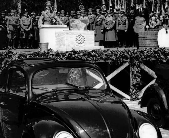 FILE - In this May 26, 1938 file photo, German Nazi leader Adolf Hitler speaks at the opening ceremony of the Volkswagen car factory in Fallersleben, Lower Saxony, Germany. Volkswagen is halting production of the last version of its Beetle model in July 2019 at its plant in Puebla, Mexico, the end of the road for a vehicle that has symbolized many things over a history spanning eight decades since 1938.