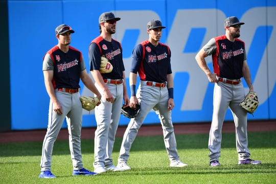 July 9, 2019; Cleveland, OH, USA; (From left to right) National League outfielder Jeff McNeil (6) of the New York Mets, infielder Kris Bryant (17) of the Chicago Cubs, outfielder Christian Yelich (22) of the Milwaukee Brewers, and outfielder David Dahl (26) of the Colorado Rockies prior to the 2019 MLB All Star Game at Progressive Field. Mandatory Credit: Ken Blaze-USA TODAY Sports