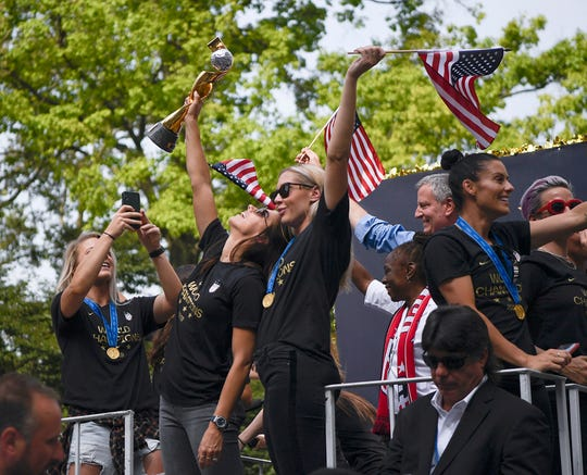 Alex Morgan poses with the World Cup trophy as the U.S. Women's National Soccer Team celebrate their fourth World Cup win with a ticker tape parade down the Canyon of Heroes on Wednesday, July 10, 2019, in New York.