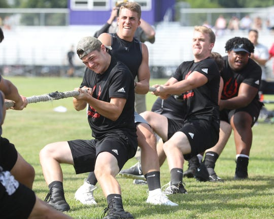 Northern Highlands linemen compete in the tug of war portion fo the Lineman's Challenge.