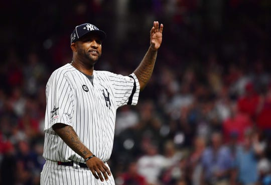 July 9, 2019; Cleveland, OH, USA; New York Yankees pitcher CC Sabathia visits American League pitcher Aroldis Chapman (not pictured) of the New York Yankees on the mound during the ninth inning in the 2019 MLB All Star Game at Progressive Field. Mandatory Credit: Ken Blaze-USA TODAY Sports