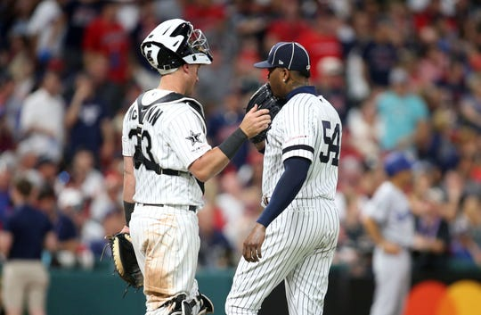 Jul 9, 2019; Cleveland, OH, USA; American League catcher James McCann (33) of the Chicago White Sox talks with American League pitcher Aroldis Chapman (54) of the New York Yankees prior to the 9th inning in the 2019 MLB All Star Game at Progressive Field.