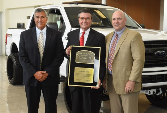 Art LeBlanc, center, Sterling Ford owner, is presented the Presidents Award from Greg Houston,right, Ford Motor Company regional manager. PIctured at left is Robert Cook, Sterling Ford general manager. The presentation was made Wednesday at the Opelousas dealership.