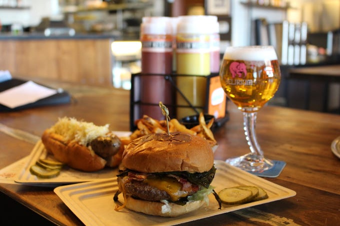 A selection of food and drink from Brat Haus. The restaurant just opened a second location in Uptown Phoenix.