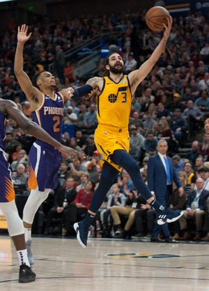 Ricky Rubio #3 of the Utah Jazz drives to the basket ahead of Elie Okobo #2  of the Phoenix Suns during their game at the Vivint Smart Home Arena on February 6, 2019 in Salt Lake City , Utah.