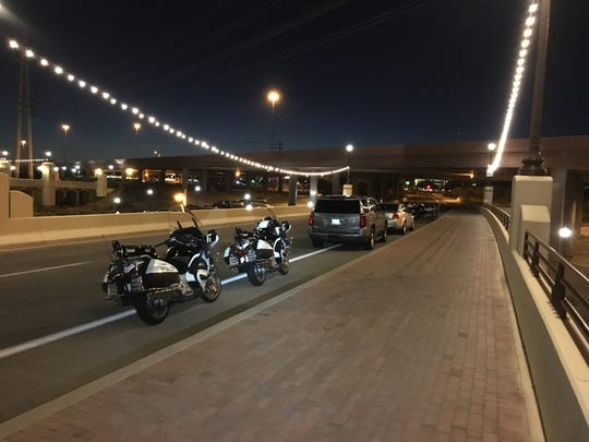 Several police vehicles lined the Mill Avenue bridge on July 9, 2019, as the investigation into a fatal self-driving car crash continued.