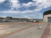Part of the sidewalk leading up to the pedestrian footbridge will be closed due to the investigation, Barela said.