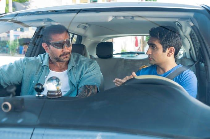 "Dave Bautista (left) and Kumail Nanjiani star in ""Stuber."""