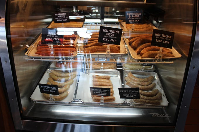 A selection of sausages for sale at Brat Haus's newest location in Uptown Phoenix. Guests can purchase the sausage to go to make on their own.