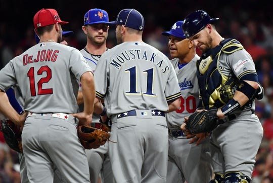 National League manager Dave Roberts of the Los Angeles Dodgers talks with his team during the seventh inning of the 2019 MLB All Star Game at Progressive Field.