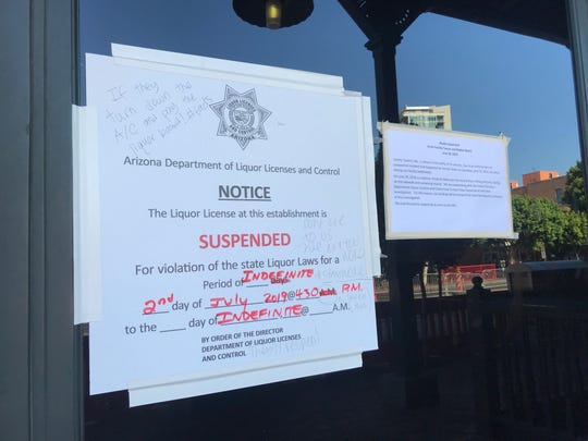 Notices on the door of Varsity Tavern in Tempe. The bar closed following a June 29 incident.