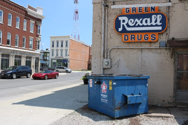 Local officials in Port Clinton are looking into the issue of dumpsters left out in the open to public view, such as this one on the south side of Second Street in the heart of the downtown district.