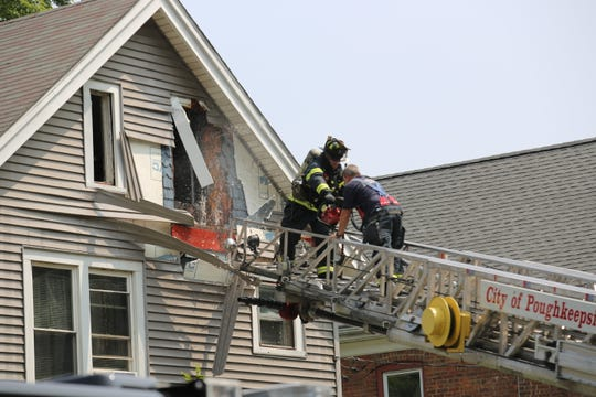 Firefighters respond toa blaze at an Orchard Place home in the City of Poughkeepsie.