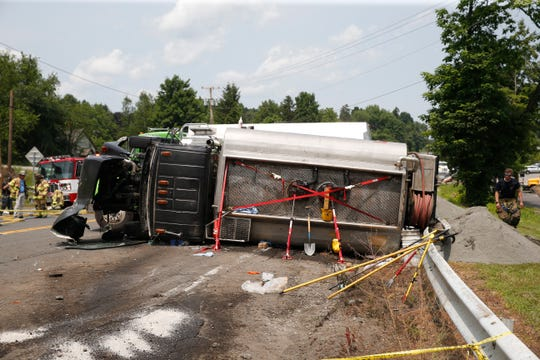 An overturned fuel oil truck closed Route 9 W in Milton on July 10, 2019. The truck came to a rest adjacent to the Marlborough Highway Department who's workers sprang into action and created a gravel and sand dam to prevent the fuel oil from spilling into a nearby creek.