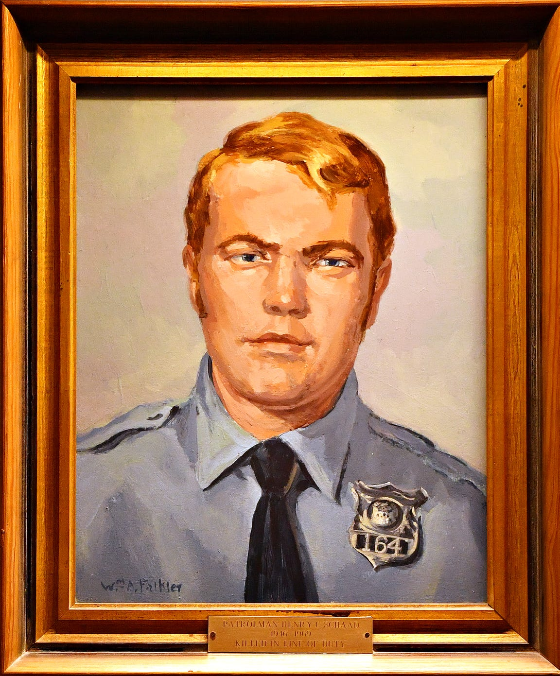 A portrait of Patrolman Henry C. Schaad, 22. hangs on the wall inside the York City Police Department, Wednesday, July 9, 2019. Schaad was mortally wounded in the line of duty during the York race riots on July 18, 1969. Dawn J. Sagert photo