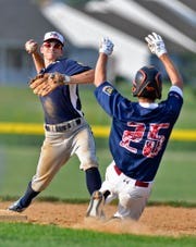 Spring Grove's Brock Allison makes the turn for the double play after getting the force out on Michael Livingston during American Legion baseball playoffs, Tuesday, July 9, 2019.