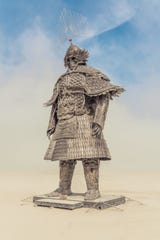 Lu Ming's Desert Guard statue, on the Black Rock Desert playa at Burning Man, is being installed in Reno's downtown.
