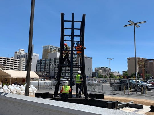 """SQUARED,"" a 50-foot tree-like LED lantern sculpture built by industrial artist Charles Gadeken, is being installed in downtown Reno as part of  Jacobs Entertainment's Neon Line project."