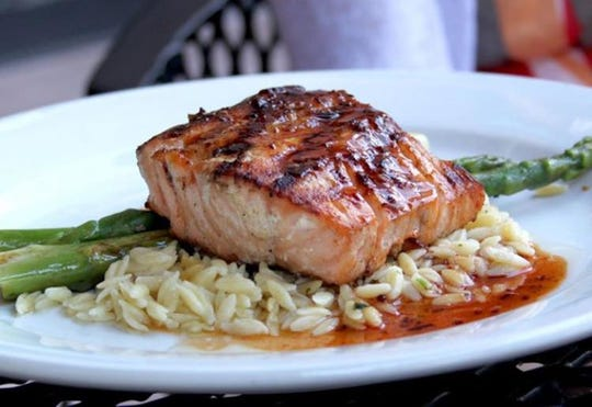 Plum chipotle salmon is a signature dish at Wild River Grille, on the menu since the beginning.