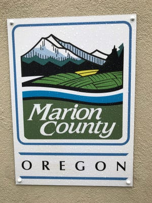 The Marion County logo outside the Health and Human Services building on Silverton Road in Salem.