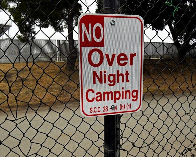 "A ""No Over Night Camping"" sign meant to prevent homeless encampments hangs on a chain-link fence in Salinas. July 10, 2019."