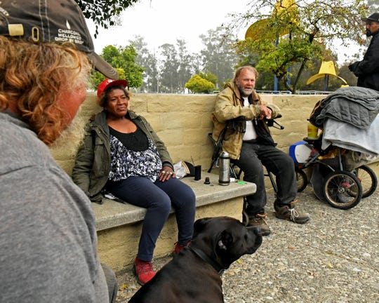 Bill Doss, Cherie Hernandez and Mike James gathered Wednesday morning at the benches in Sherwood Park where Hernandez, Doss, and dozens of other homeless people have lived for years. They were exhausted, having slept very little after police told them to leave the night before. They returned as soon as they were permitted. July 10, 2019.