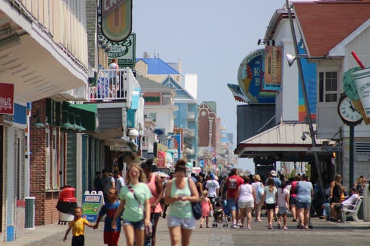 Crowds walk around the boardwalk near Jolly Rogers at the Pier in Ocean City on July 10, 2019.