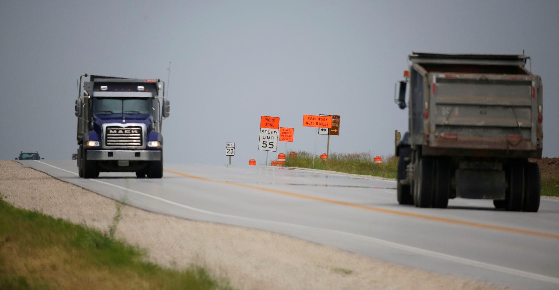 State Highway 23: Road construction carves the new lanes in