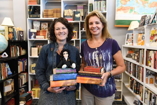 Reach Literacy Executive Director Paige Carda and volunteer Mary Kool hold source material for planning a Harry Potter Block Party on Wednesday, July 10. The event is scheduled for the end of the month.