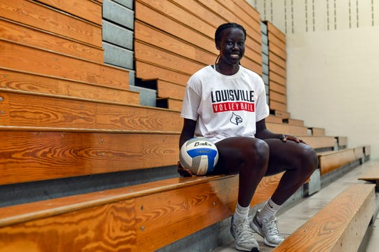 Phekran Kong, a senior at Washington High School, will play volleyball for the University of Louisville next fall. She poses for portraits Wednesday, July 10.