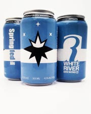 "Cans of beer manufactured by White River Brewing Company bearing Springfield's unofficial ""Springfield Flag Movement"" emblem."